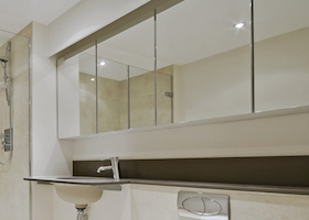 luxury modern en-suite bathroom with floor to ceiling marble tiles
